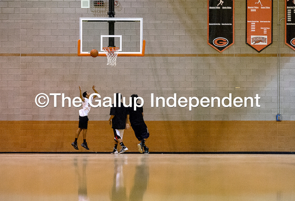 110413    Brian Leddy<br /> A trio of boys run a drill at Gallup High School. Monday marked the first day of practice for the Gallup boys basketball team.