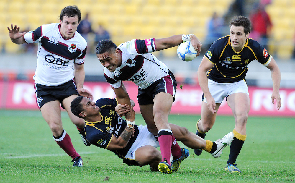 North Harbour's Francis Saili fends off Wellington's Ope Peleseuma in the ITM Cup rugby match, Westpac Stadium, Wellington, New Zealand, Saturday, September 29, 2012. Credit:SNPA / Ross Setford