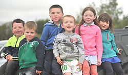 Some of the younger Burrischoole's supporters keeping an eye on  Intermediate championship match on saturday evening last, from left Finn McHale, Joshua and Tadgh Holmes, alondg with Brian, Maria and Tara Keane.<br /> Pic Conor McKeown