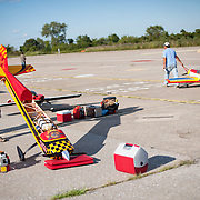 September 9, 2012 - Brooklyn, NY : Once New York City's municipal airport, Floyd Benneyt Field is now administered by the Parks Department as a recreation site. The old runways remain -- providing ideal space to ride bikes and fly model airplanes.  Pictured here, remote control airplane pilots including Sam Masyr, foreground left, work on and fly their planes at Floyd Bennett Field on Sunday afternoon. CREDIT: Karsten Moran for The New York Times