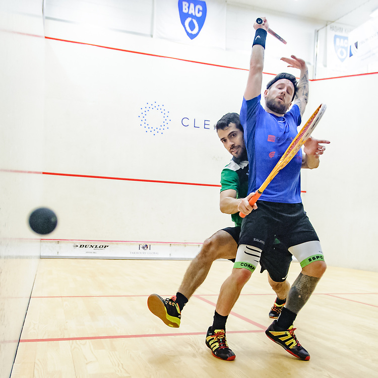 BIRMINGHAM, MICHIGAN, USA - JANUARY 31: Peter Creed (Wales), front, and Cesar Salazar (Mexico) compete in a qualifying round during the 2018 Motor City Open (MCO), presented by The Suburban Collection, squash tournament Wednesday, January 31, 2018 at the Birmingham Athletic Club in Birmingham, Michigan. (Photo by Bryan Mitchell for BAC)