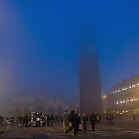 VENICE, ITALY - NOVEMBER 20:  An evening view of St Mark's Square with the belfry and Palazzo Ducale as thick fog shrouds the city, on November 20, 2011 in Venice, Italy. Venice woke up this morning under a heavy blanket of fog adding to the atmosphere of the city. <br /> <br /> HOW TO LICENCE THIS PICTURE: please contact us via e-mail at sales@xianpix.com or call our offices London   +44 (0)207 1939846 for prices and terms of copyright. First Use Only ,Editorial Use Only, All repros payable, No Archiving.© MARCO SECCHI