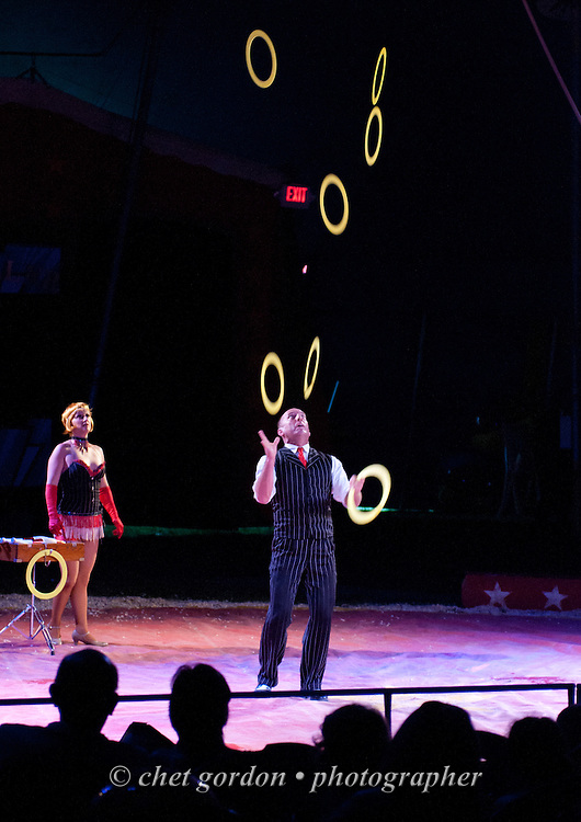 A juggler performs during the Kelly Miller Circus in Greenwood Lake, NY on Monday June 15, 2015.  © Chet Gordon • Photographer