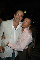 Left to right, PAUL McKENNA & FRANKIE DETTORI at a party hosted by Frankie Dettori, Marco Pierre White and Edward Taylor to celebrate the launch of Frankie's Italian Bar & Grill at 3 Yeoman's Row, London SW3 on 2nd September 2004.