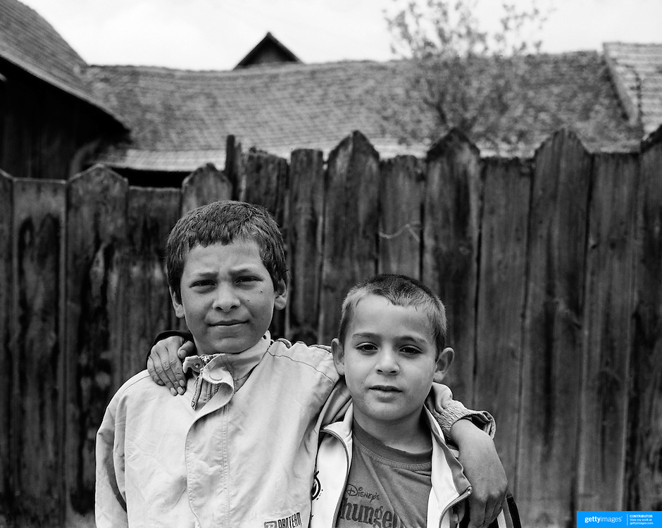 Two young friends pose in the small town of Rupea in the heart of Transylvania, Romania. Photo Tim Clayton..Romania entered the European Economic Community in January 2007, signaling a fresh exodus of the work force as many Romanians fled the country in search of a better life. Sadly many have not found the employment sought and Romanian communities camped in European cities are making headlines for all the wrong reasons...In a nation recovering from communist rule from 1947 to 1989 and a decade of economic instability and decline that followed, it is estimated Romania has lost between 2.0 and 2.5 million of it's workforce since the end of communist rule. Considering Romanian's population is estimated at 22 million, this is about 10% of the Country's population...Life goes on as normal for those who have remained in Romania. In a country steeped in history and culture there has been little or no change in age old traditions, life is personified in the rural communities where a third of Romanian's population is employed in agriculture and primary production, one of the highest in Europe.