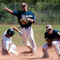 23 May 2010: Stosh Hoover of Montpellier throws the ball for the double play during game 1/week 7 of the French Elite season match won 19-9 by Montpellier over the PUC, at the Pershing Stadium in Vincennes, near Paris, France.
