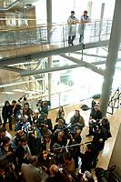15 APR 2003, BERLIN/GERMANY:<br /> Ruediger Veit (unten-mitte), MdB, SPD, gibt Journalisten  ein Statement, nach einem Gespraech von F ranz M uentefering mit den Unterzeichnern eines Mitgliederbegehrens gegen die Reformplaene des Bundeskanzlers, eine Ebene hoeher verfolgen zwei Putzfrauen das Geschehen, Jakob-Kaiser-Haus <br /> IMAGE: 20030415-03-014<br /> KEYWORDS: Journalist, Mikrofon, microphone,