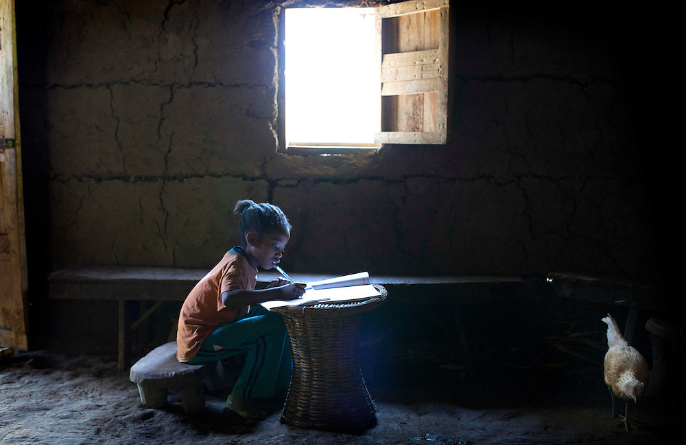 Ethiopia: Day 03 Aleta Chuko<br /> Selamaw studies by the light of the window.<br /> Photograph: Rosie Hallam