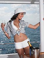 Young woman drinking champagne on yacht