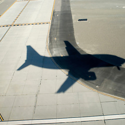 An airplane casts a shadow on the runway in Reno, Nevada.