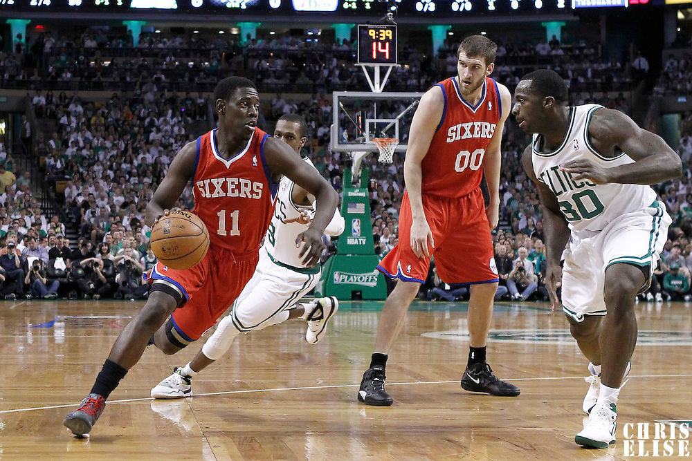 26 May 2012: Philadelphia Sixers point guard Jrue Holiday (11) drives past Boston Celtics point guard Rajon Rondo (9) during the Boston Celtics 85-75 victory over the Philadelphia Sixer, in Game 7 of the Eastern Conference semifinals playoff series, at the TD Banknorth Garden, Boston, Massachusetts, USA.