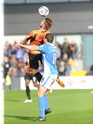 Barnets Elliott Johnson, Beats Eastleighs Craig Stanley to the ball, Barnet v Eastleigh, Vanarama Conference, Saturday 4th October 2014