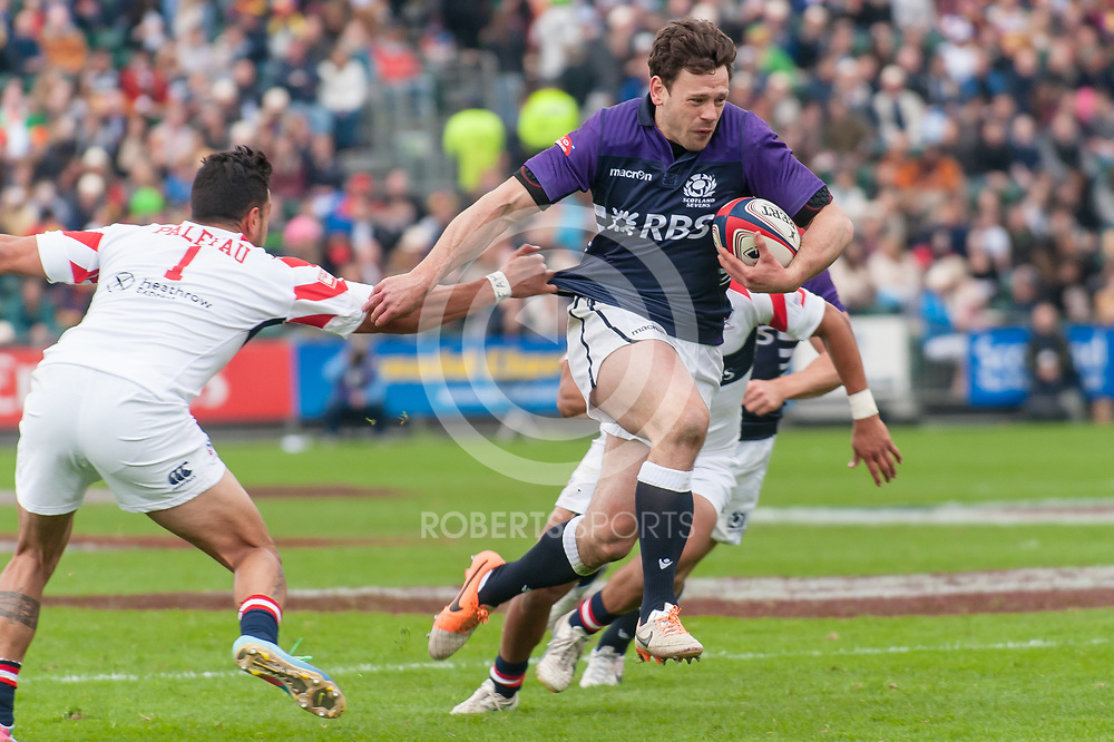 Scotland's Nick de Luca bursts through the USA defence to score a try. Action from the IRB Emirates Airline Glasgow 7s at Scotstoun in Glasgow. 3 May 2014. (c) Paul J Roberts / Sportpix.org.uk