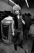 Photo of Adam Clayton - U2 at a Jukebox store in Atlanta - USA tour photosessions December 1981