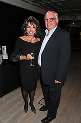 JOAN COLLINS and CHRISTOPHER BIGGINS at a party to celebrate the publication of her  autobiography - The World According to Joan, held at the British Film Institute, South Bank, London SE1 on 8th September 2011.