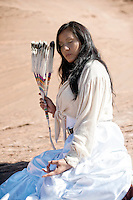 Modern American Indian Woman holding her hand in the yoga mudra.<br />