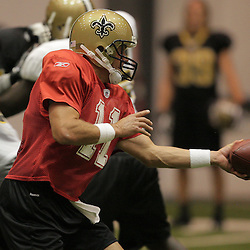 12 August 2009: New Orleans Saints quarterback Mark Brunell (11) looks to handoff during New Orleans Saints training camp at the team's indoor practice facility in Metairie, Louisiana.