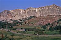 Snowy Range Scenic Byway (HWY 130) passes by Bellamy Lake below the Snowy Range.  Wyoming, USA.