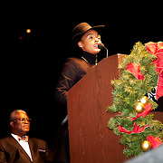 Janelle Monáe speaking at the Mayor's Christmas Tree Lighting, Kansas City Mayor Sly James in background.