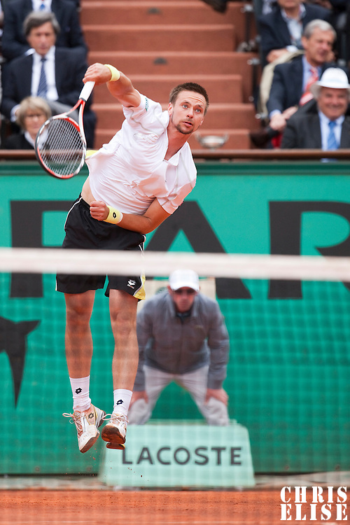 7 June 2009: Robin Soderling of Sweden serves against Roger Federer during the Men's Singles Final match on day fifteen of the French Open at Roland Garros in Paris, France.