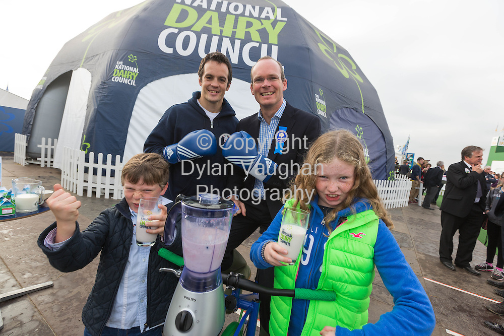 Repro Free no Charge For Repro<br /> <br /> 25/9/13<br /> <br /> PLOUGHING &ndash; WORLD SCHOOL MILK DAY<br /> CELEBRATED BY NATIONAL DAIRY COUNCIL<br /> - Milk: a relatively inexpensive source of nutrients -<br />   <br /> World School Milk Day is designated by the UN (United Nations) Food &amp; Agriculture Organisation (FAO).   This year World School Milk Day is Wednesday 25th September &ndash; giving the National Dairy Council an opportunity to highlight its role in promoting school milk and in dairy education at the NDC Dome at the National Ploughing Championships.<br />  <br /> Children from 3rd class of Rath National School, Ballybrittas, Portlaoise, Co Laois, were at the NDC Dome to celebrate World School Milk Day, where they met with Irish Olympic boxer Darren O&rsquo;Neill and Simon Coveney T.D., Minister for Agriculture, Food &amp; The Marine.<br />  <br /> NDC Nutritionist Caroline O&rsquo;Donovan says that World School Milk Day creates a platform to highlight to Irish families that milk is not only a readily available and convenient drink, but that it also provides consumers with a relatively inexpensive source of nutrients.&shy;&shy;<br />  <br /> &ldquo;Milk provides a package of nutrients such as calcium, protein, iodine, vitamin B2 and vitamin B12.  So, not only is milk an  affordable source of a range of important nutrients &ndash; but the versatility of milk and milk products makes them great value for money too, as they are perfect for use in a wide range of cooked and baked dishes and across many meal time and snacking occasions,&rdquo; says Caroline.<br />  <br /> Teachers and primary school students are invited to  www.moocrew.ie;  with teenagers and secondary school teachers invited to visit www.milkitawards.ie to find out about the dairy education initiatives and competitions for their schools.<br />  <br />  <br /> Pictured at the NDC Dome at the ploughing championships were Irish Olympic boxer Darren O&rsquo;Neill,  Simon Coveney T.D., Mini