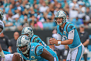 Sunday, October 6, 2019; Charlotte, N.C., USA;  Carolina Panthers quarterback Kyle Allen (7) prepares to receive the snap from Carolina Panthers center Matt Paradis (61) during an NFL game against the Jacksonville Jaguars at Bank of America Stadium. The Carolina Panthers beat the Jacksonville Jaguars 34-27. (Brian Villanueva/Image of Sport)