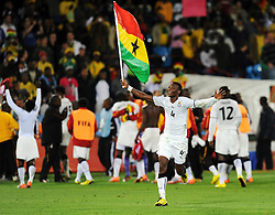 John Pantsil (Ghana) celebrates with the Black Stars flag after the 2010 FIFA World Cup South Africa Group D match between Serbia and Ghana at Loftus Versfeld Stadium on June 13, 2010 in Pretoria, South Africa.