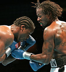 Light Heavyweights Eric Harding (r) and Daniel Judah (l) trade punches during their 12 round NABF Light Heavyweight title fight at the Mohegan Sun Arena in Uncasville, CT.  Harding won the title via 12 round unanimous decision.