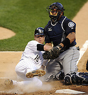 CHICAGO - JUNE 07:  Gordon Beckham #15 of the Chicago White Sox is tagged out at home plate by Miguel Olivo #30 of the Seattle Mariners in the third inning on June 7, 2011 at U.S. Cellular Field in Chicago, Illinois.  The White Sox defeated the Mariners 5-1.  (Photo by Ron Vesely)  Subject:  Gordon Beckham;Miguel Olivo