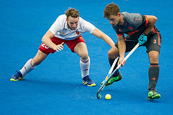 England's Chris Griffiths tackles Tristan Algera of The Netherlands. England v The Netherlands - Semi Final - Hockey World League Semi Final, Lee Valley Hockey and Tennis Centre, London, United Kingdom on 24 June 2017. Photo: Simon Parker