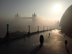 © London News Pictures. 14/03/2014.  London UK. Fog covers Tower Bridge on the River THmaes, seen from City Hall on the South bank in London early morning on 14th March 2014. Photo credit: Colin GauntLNP