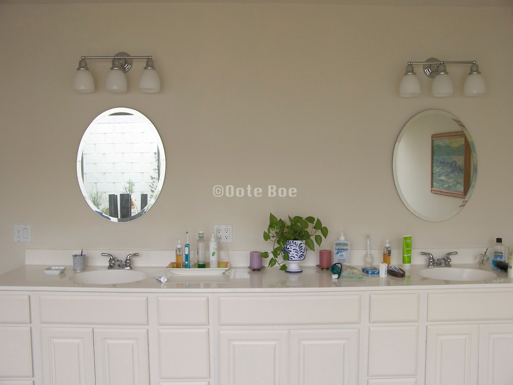 a long bathroom table with two mirrors
