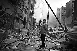 Residents of Beirut's southern suburbs, which are the stronghold of the militant group Hezbollah, check damage to their homes and neighborhood after a series of Israeli air strikes flattened much of the area of Beirut, Lebanon on July 16, 2006.