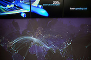 In the company chalet, we see a Boeing ad presentation of their 787 Dreamliner at the Farnborough Airshow. It shows us the 20% lower fuel consumption and operating costs along with beautiful graphics of the plane itself and its future dominance around the world's air routes. The Boeing 787 Dreamliner is a long range, mid-sized, wide-body, twin-engine  jet airliner developed by Boeing Commercial Airplanes. It seats 210 to 330 passengers, depending on variant. Boeing states that it is the company's most fuel-efficient airliner and the world's first major airliner to use composite materials for most of its construction