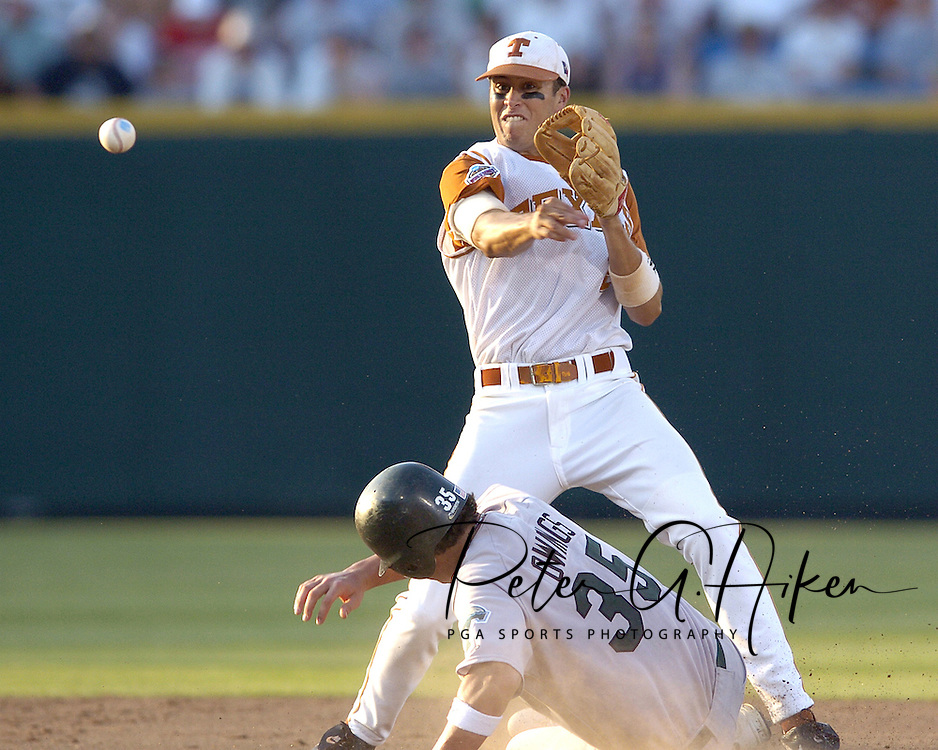 Texas shortstop Seth Johnston (2) throws to first base after forcing out Tulane's Micah Owings (35) in the sixth inning.  Texas defeated Tulane 5-0 in the second round of the College World Series at Rosenblatt Stadium in Omaha, Nebraska on June 20, 2005.