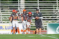 KELOWNA, BC - AUGUST 3:  Head coach Jamie Boreham stands on the sidelines during warm up with Jonah Williams #34, Garrett Cape #2 and Michael Guirestante #36 of Okanagan Sun against the Kamloops Broncos at the Apple Bowl on August 3, 2019 in Kelowna, Canada. (Photo by Marissa Baecker/Shoot the Breeze)