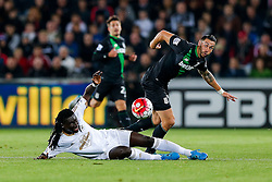 Bafetibis Gomis of Swansea City and Geoff Cameron of Stoke City compete for the ball - Mandatory byline: Rogan Thomson/JMP - 07966 386802 - 19/10/2015 - FOOTBALL - Liberty Stadium - Swansea, Wales - Swansea City v Stoke City - Barclays Premier League.