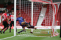 Photo: Lee Earle.<br /> Brentford v Bradford City. Coca Cola League 1. 02/09/2006. Bradford's Mark Bower (2ndR) beats Brentford keeper Stuart Nelson to score their first from close-range.