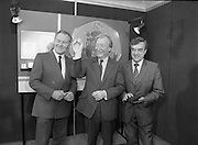 First Millennium 50p Coin.   (R80)..1988..31.06.1988..06.31.1988..31st June 1988..The Governor of the Central Bank of Ireland, Mr Maurice F Doyle, presented the first of a limited issue of proof 50p coins commemorating the Dublin Millennium to An Taoiseach, Charles Haughey TD, this morning. Only 50,000 of these frosted proof coins will be issued for worldwide distribution...Image shows Mr Maurice Doyle, Governor, Central Bank of Ireland,An Taoiseach, Charles Haughey TD, and Mr Thomas Ryan, President, Royal Hibernian Academy, who designed the new 50p coin, at the presentation of the new coin.
