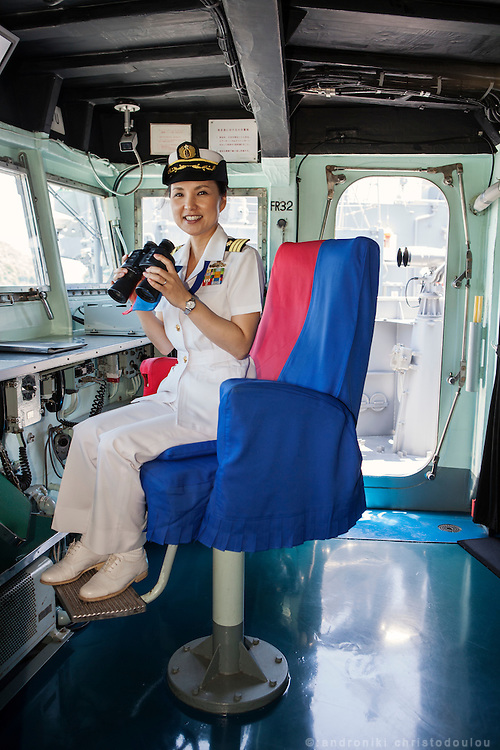 Miho Ootani, the first woman destroyer captain of Japan's Marine Self Defence Forces (MSDF), on board the Yamagiri in Yokosuka army base near Tokyo. Here siting on her official post, the captain's chair inside the bridge of the ship.