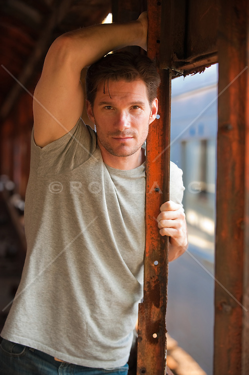 Portrait of a man in a rusted out train