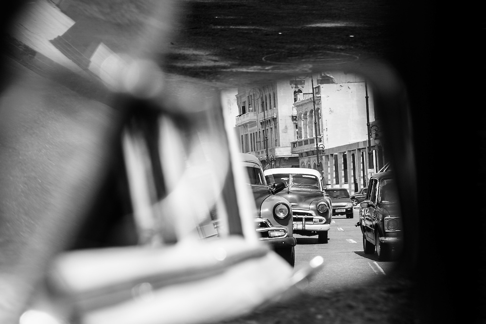 Where: Havana, Cuba.<br />  I love the abstract layers of this photograph taken from the passenger seat of the old classic car mirror.