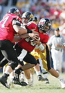 01 SEPTEMBER 2007: Northern Illinois quarterback Dan Nicholson (19) runs into offensive guard Tim Mayerbock (77) in Iowa's 16-3 win over Northern Illinois at Soldiers Field in Chicago, Illinois on September 1, 2007.