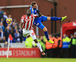Christian Fuchs of Leicester City battles for the ball with Mame Biram Diouf of Stoke City - Mandatory by-line: Paul Roberts/JMP - 04/11/2017 - FOOTBALL - Bet365 Stadium - Stoke-on-Trent, England - Stoke City v Leicester City - Premier League