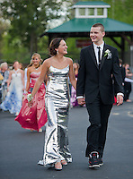 It feels like a night at the Grammy's for Jeannine Parsons and Anthony Ciampa as they march during into Laconia High Schools Prom at Meadowbrook on Friday evening.   (Karen Bobotas/for the Laconia Daily Sun)
