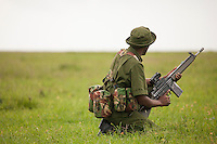 An armed ranger scans the horizon for signs of trouble in a key rhino reserve in Kenya. Rangers are the frontline of the war against poaching. Their jobs are dangerous.