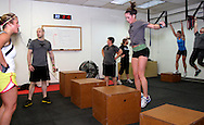 (from left) Gabi Sawyer of Beavercreek, owner Jason Hoskins of Dayton, Sarah Stewart of Kettering, .Tracy Belt of Kettering, Alyssa Medeiros of Beavercreek, Nicole Hughes of Dayton and Sarah Collinsworth of Dayton during a workout of the day session at Vigor Crossfit in Moraine, Wednesday, January 25, 2012.