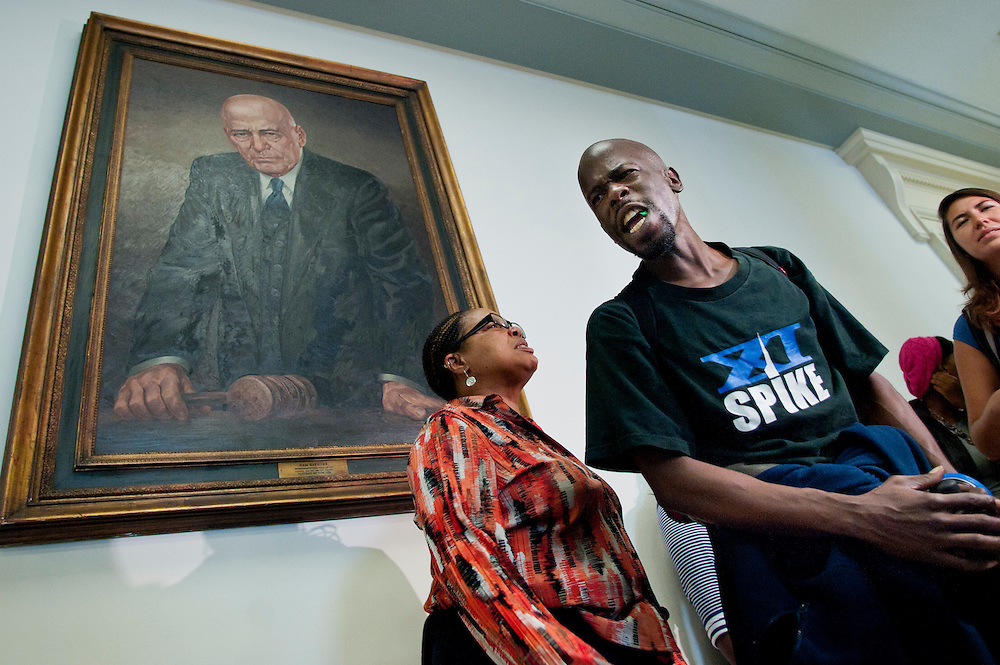 """A small group of protestors gathered underneath a portrait of former Senator Sam Rayburn outside of the committee room as the Joint Deficit Reduction Committee meets on Capitol Hill Thursday. The protestors were calling for """"Jobs Now."""" The Committee convened its first meeting to make opening statements and consider proposed committee rules. The committee has a 76-day deadline to come up with a deficit reduction plan totaling $1.5 trillion that can win congressional approval."""