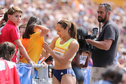 Jessica Ennis-Hill of Great Britain signs a fan's t-shirt during the Sainsbury's Anniversary Games at the Queen Elizabeth II Olympic Park, London, United Kingdom on 25th July 2015. Photo by Ellie Hoad.