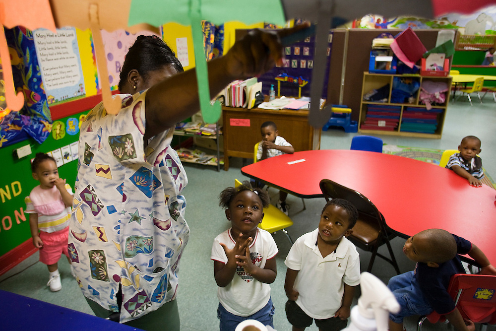 Ms. Katherine Clark leads children under her care in a lesson about color at the New Covenant House Christian Daycare Center in Clarksdale, Miss., May 15, 2007.<br />